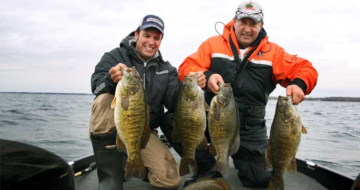 smallmouth record - two men with trophy bass