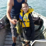 Darren Peterson and his son Evan, 7, on Lake St. Clair