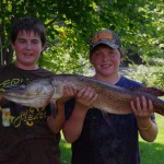 Dean Sealey, 13, caught this 14 1/2 pound, 43 1/2 inch pike with his friend Colton on Smith Lake.