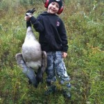 Ethan, 9, helped show off the day's efforts at the Wye Marsh in Midland on his very first outing.