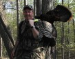 """Ian Mcleary with a great bird! """"Being in the woods while the sun rises and hearing a turkey gobble is a magical experience. Calling to that turkey and having him come in is an opportunity of a lifetime! Thanks to the MNR, NWTF, OFAH and all others who made turkey hunting in Ontario possible – it means the world to us!"""""""