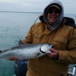 Jamie Grover with his first Chinook salmon downrigging on Lake Huron.