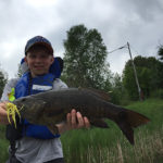 10-year-old Everett with his bass caught on Round Lake.