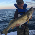 James Nocente, 8, with a beauty walleye he landed while out trolling Lake Erie.