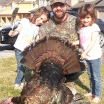 Harvested this 22lb Tom on the May 2nd weekend in the Peterborough, Area Twins, Kenley and Ellyot Wood pose with their Dad while holding Mom's mothers day present, a turkey dinner!