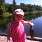 Alena Minten, 4, lands her first fish using a worm and bobber at Pinery Provincial Park