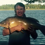 Paul Mussell of Osgoode, Ontario fishing early in the morning on the Rideau River caught a 20+ pound carp