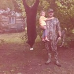 Jeff Dalton holds his son Sevrin as they pose with his first black bear