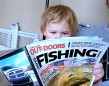 "It's never too early to start. Iain Horne of Manitouwadge submitted this photo of two-year-old McKinnon who likes reading OOD as much as his dad, and pointing out all the ""fishies""."