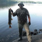 Jason Bobbitt says he used tips from Ontario OUT of DOORS magazine to land this northern pike from shore in the backcountry on Noganosh Lake.