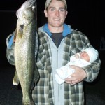 """""""A proud moment for dad, Justin Hawn, of North Bay, Ontario as he holds an 11 pound walleye in one hand while cradling his one-month-old son Jayven in the other. Jayven was half the size of the catch, weighing 5.5 pounds."""""""