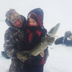 Rob Matthews with six-year-old son Keegan. It was Keegan's first time ice fishing. It took five minutes to hook this 27-inch northern pike and another 10 minutes of fighting before the fish was pulled from the hole.