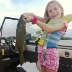 Mackenzie Cashmore, 8, was able to pull in her first upper Niagara River small mouth, weighing in at 3.5 pounds.