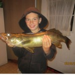 "Brennen Moore, 8, snagged this 25"" walleye out trolling one night"