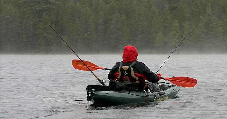 kayak trolling - man fishing in a kayak