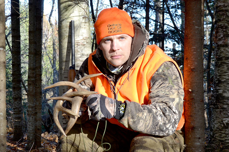 aggressive - Drew Myers holding antlers, calling deer