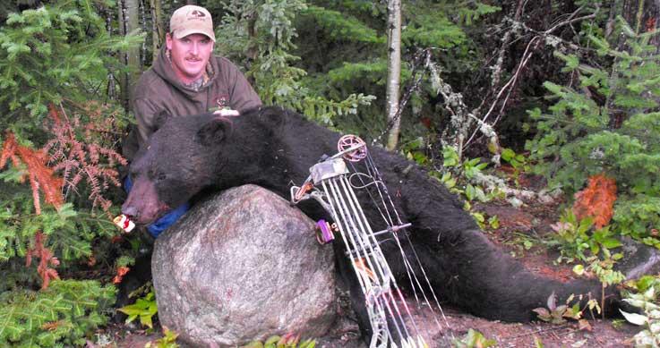 record bear - man with bear