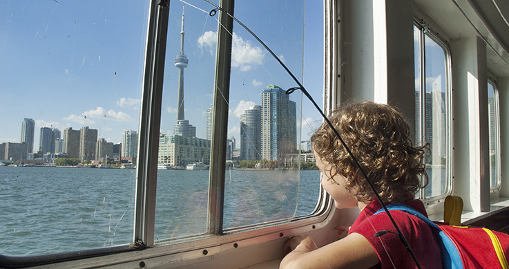 girls with a fishing rod on a ferry