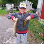 Aidan B. with his first ever walleye caught while pan fishing