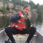 Alex North was fishing her favorite spot on the French River when she landed this small mouth bass. Her biggest to date!