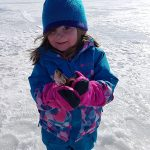 Aubrey Begin caught her first fish, a 7-inch perch, while out on the ice with her dad Bob.