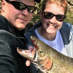 Darrin Parfit and Nicole Lange with a rainbow trout in Bowmanville.