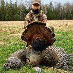 Brayden Okum, 13, with his first turkey!