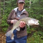 Cherie Duffield displays her first walleye of the season, caught on Lake Abitibi.