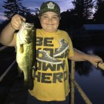 Jesiah Fleming of Lindsay holds up a smallmouth caught on the Gull River at Elliott Falls.
