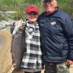 Jim Hughes of Maynooth with a trout caught on Lake Nipigon with grandson Javin Hughes.