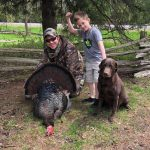 Jordan Foote of South Dundas poses with son Cooper and his second turkey harvest of the year.