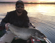 Mike Sanna of Barrie with a Lake Simcoe lake trout caught on a soft plastic.