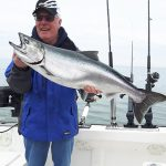 Larry Roszell of Branchton was fishing out of Port Dalhousie on Lake Ontario when he landed this chinook salmon with an assist from his son Bob, with a great net job.