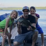 Sean Porter is flanked by Mackenzie and Emily Porter while bass fishing at Grandma's house on Lake Duborne in Blind River.