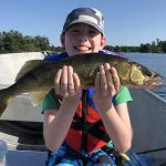 """Jordan Price of Guelph with a walleye caught and released on Stoney Lake on a lure made by his father, Graham. """"It was a very proud moment being with him and watching him catch his new personal best!"""" dad wrote."""