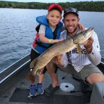 """Ethan Strong and his young friend Reed were fishing for walleye near Minden when this northern Pike smashed their jig. It was the biggest fish Reed has seen caught. He was so excited all he could say was """"all I want to do it pet the fish,"""" Strong wrote."""