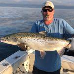 Phil Zywot of Toronto celebrates catching this trophy Lake Ontario Atlantic salmon.