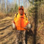 Dave Anderson of Hamilton with two ruffed grouse harvested with his dad.