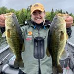 Emily Enns of Kenora holds up largemouth bass caught in Sioux Narrows.
