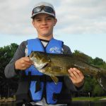 Jim Rice of Barrie sent in this photo of his nephew Ryan Rice with a smallmouth bass caught on a topwater lure on Lake Nippissing.
