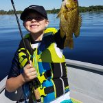 Landon Hopwood, 7, of Ottawa was all smiles after his first catch of the day while fishing with his grandfather Douglas on Calabogie Lake.