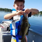 Tristan Hopwood, 6, of Ottawa was excited about the smallmouth bass he caught while fishing with his grandfather Douglas on Calabogie Lake.