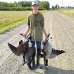 Isaac Kirby of Iron Bridge displays the harvest of his first goose hunt with his dad and uncle.