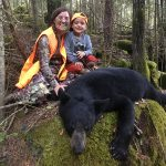 Laura McPhee and her son Griffen McPhee of Guelph with a bear Laura harvested on Manitoulin Island.