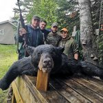 Paolo Caprara of Toronto, Giancarlo Caprara, Daniel Toigo, Vinny Sinopoli, and Max the dog with a bear harvested at Lower Twin Lakes Lodge during this year's hunt – Daniel's first bear hunt.