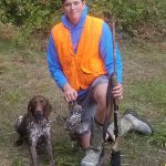 Walkerton-area resident John Edgington submitted this photo of his son A.J. and his German shorthaired pointer Bella after a grouse hunt at Grassy Lake. They were also joined by A.J.'s older brother, Jake.