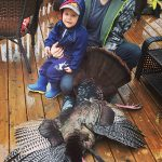 Stephen Hachey of Brantford, seen here with son Remington, harvested this turkey in Brant County with a crossbow.
