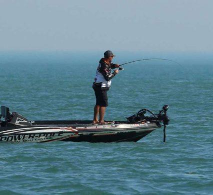 Cory Johnston fishing in boat