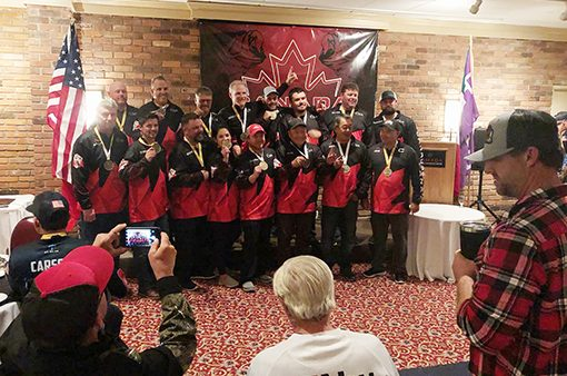 Members of Team Canada stand for a photo