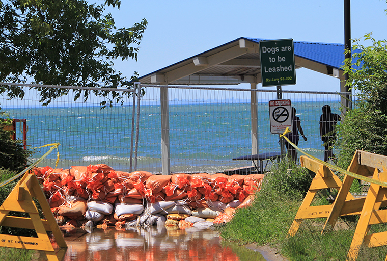 Sandbags holding back rising water on Lake Ontario